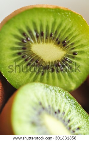 Macro kiwi flesh with selective focus. Selective focus, blur style for background use - stock photo