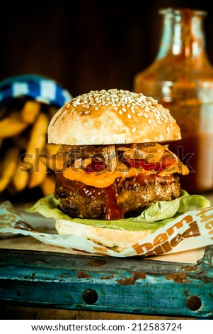 Macro Mouth Watering Handmade Burger Quarter Pounder with Frech Fries in Rustic Style. - stock photo