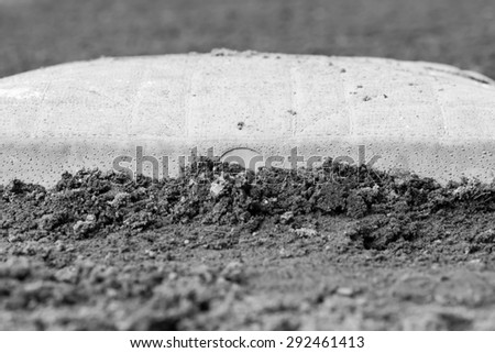 Macro of a baseball base - Black and white - Shallow depth of field