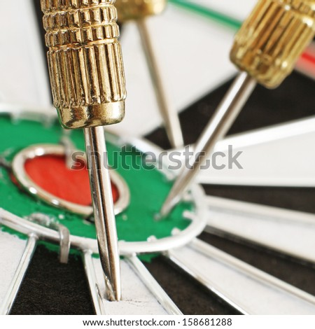 Macro of a Dart in a Dartboard - stock photo