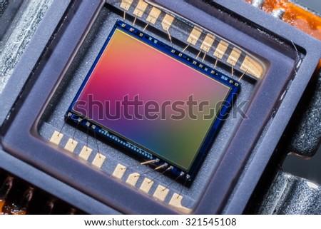 Macro of a digital camera photo sensor chip - stock photo