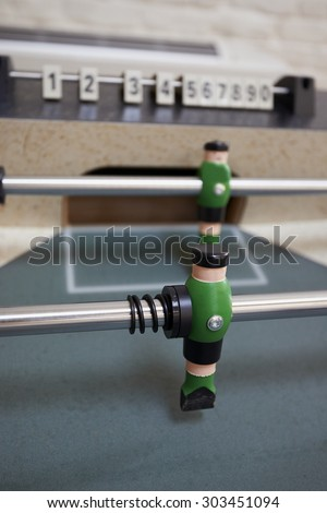 Macro of a foosball table. White character - stock photo