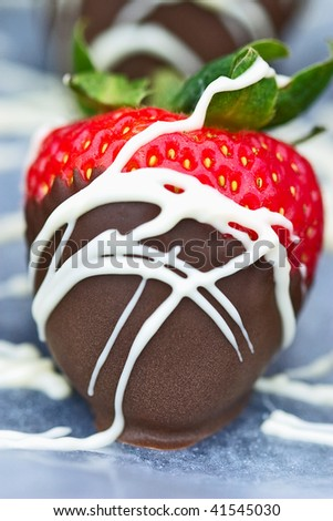 Macro of a freshly dipped chocolate covered strawberries. - stock photo