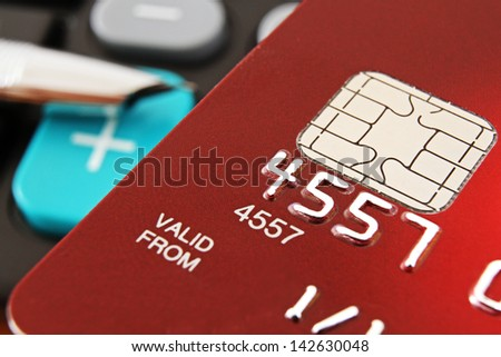 Macro of a Red Credit Card with a Micro Chip - stock photo