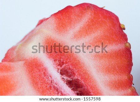 Macro of a sliced strawberry - stock photo