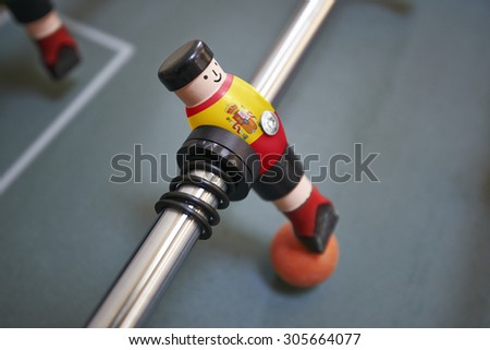Macro of a unity in a foosball match with the flag of Spain on his shirt