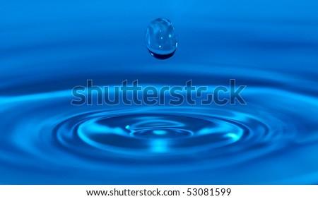 Macro of a water drop - stock photo
