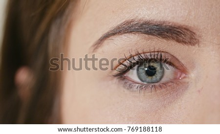 Macro of a woman's eye with the pupil constriction