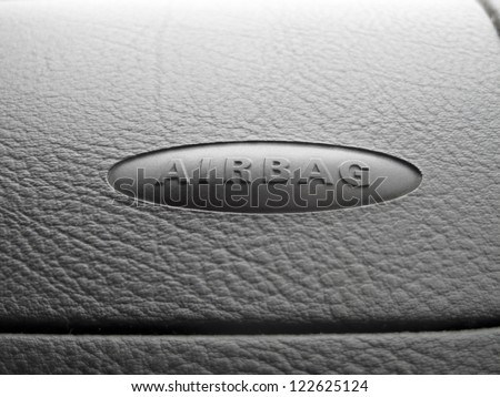 Macro of an airbag sign on a dashboard. Photo with copyspace. - stock photo