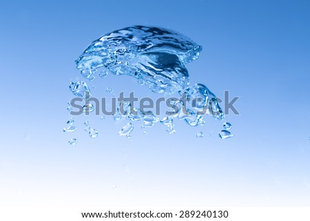 macro of big water bubble on clear water for background or backdrop - stock photo
