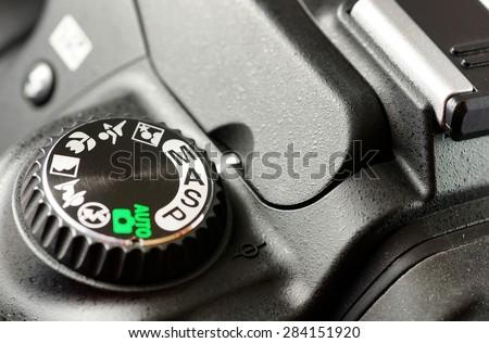 Macro of black DSLR camera. - stock photo