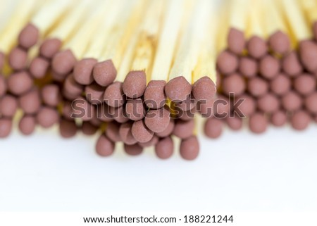 Macro of brown matchsticks or matches heads -  background or texture - stock photo