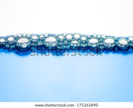 Macro of bubbles on the clear blue water able to use as background