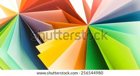 macro of colored paper arranged in fan shape. abstract background - stock photo
