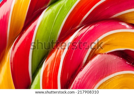 macro of colorful lollipop candy backdrop - stock photo