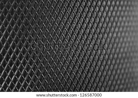 macro of crosshatch design on a hockey puck - stock photo