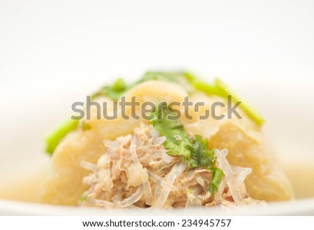 Macro of delicious bitter gourd with pork meat pudding soup on white background