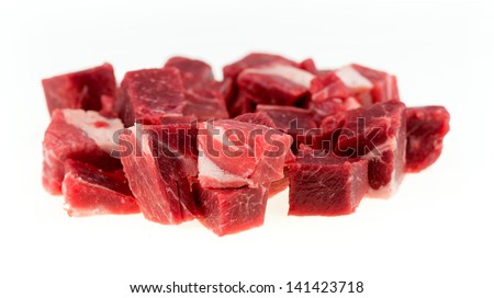 Macro of diced chunks of raw lamb and mutton meat isolated on white - stock photo