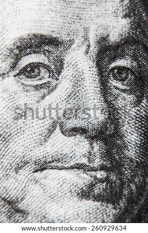 macro of 100 dollar bill with Benjamin Franklin portrait. Very shallow depth of field, focus on left eye - stock photo