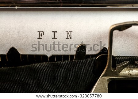 Macro of FIN (The end) text written by old typewriter machine - stock photo