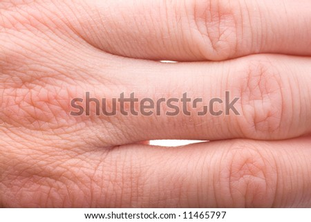 macro of fingers articulations on 40 years old male hand - stock photo