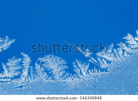 Macro of frost pattern on winter window glass  - stock photo