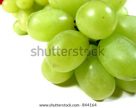 Macro of green grapes isolated on white background