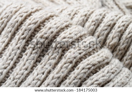 Macro of knitted beige wool for background or texture