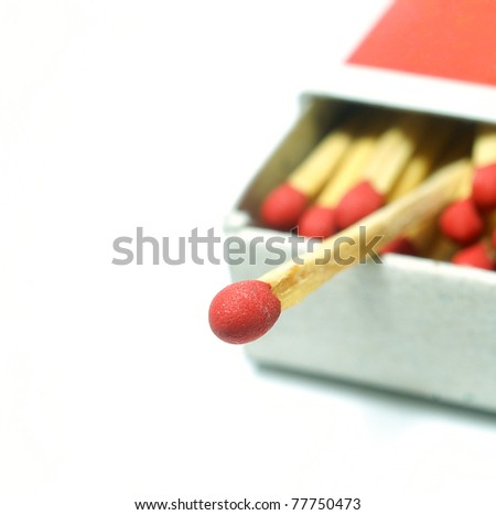 Macro of matches isolated on white background. - stock photo