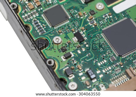 Macro of microchip on motherboard in IDE harddrive for computer technology concept - stock photo