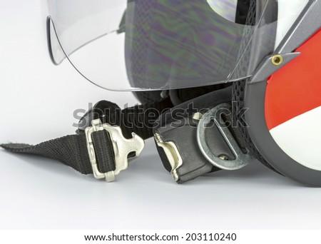 Macro of motorcycle helmet focus in locker isolated on white background - stock photo