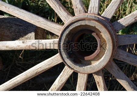 macro of old wagon wheel - stock photo