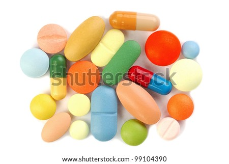 Macro of pills on white background