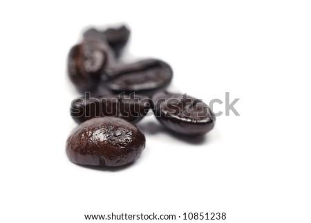 Macro of roasted coffee beans on white background - stock photo