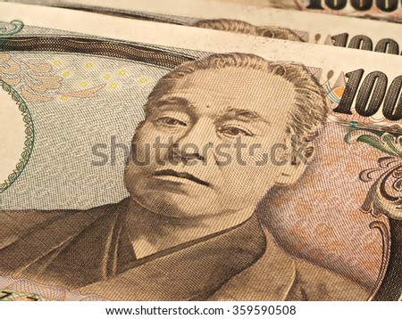 Macro of Ten thousands japanese yen bills on white background