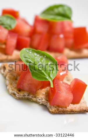 Macro of tomato crostini on white background