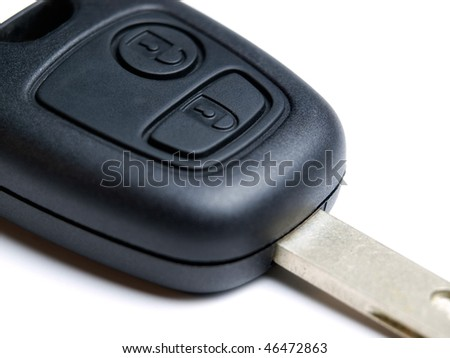 Macro of wireless electronic car key on a white background.