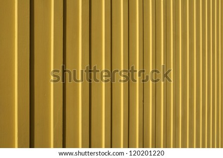 macro of yellow vertical wood siding - stock photo