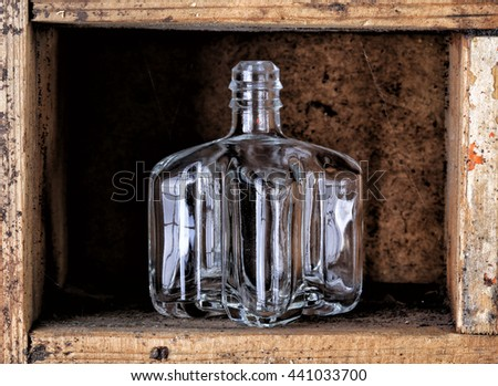 Macro old Wooden box catalog with cobwebs and small glass bottle