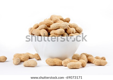 Macro peanuts on a white background.