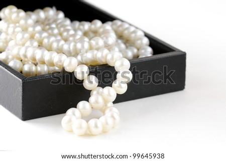 macro pearls in black gift box - stock photo