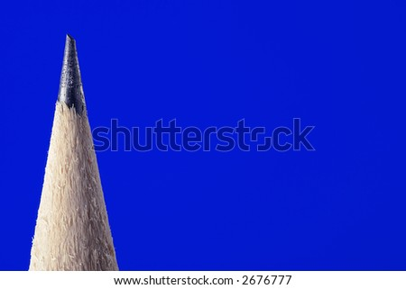 macro pencil over blue background