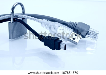 Macro photo from padlock, USB and net cables with reflections in blue toned image - stock photo