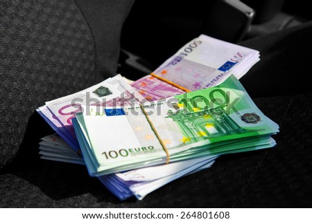 macro photo of a pack of money EUR on a car seat. Inside photo - stock photo