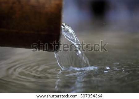 Macro photo of a water stream on  a well.