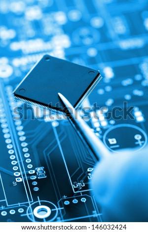 Macro Photo Of Blue Circuite Board, Assembling Line Detail. - stock photo