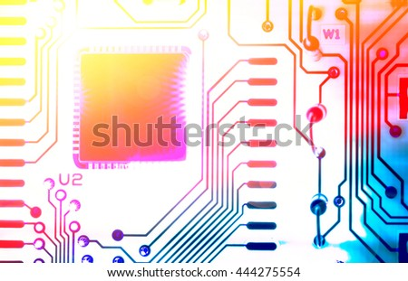 macro photo of electronic circuit with color filters - stock photo