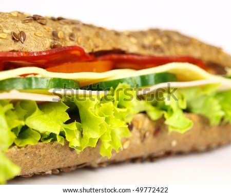 Macro photo of French wholemeal baguette sandwich on white background - stock photo