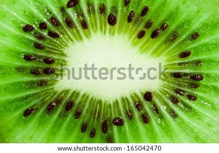 Macro photo of fresh juicy kiwi fruit - stock photo