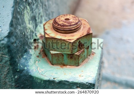 Macro photo of old rusted nuts and bolt, selective focus and shallow DOF - stock photo
